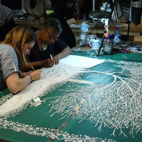 Paper cutting in Rob Ryan's studio