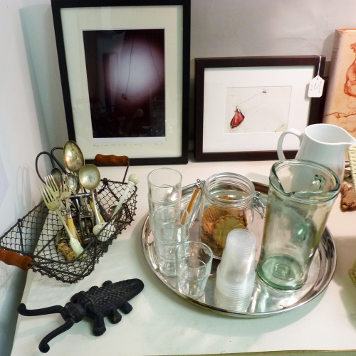 Curios, paintings and water and cookies for guests