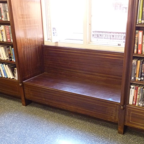 Original mahogany book stacks with in-built window seat