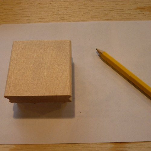 Wooden block with Speedball Speedy Carve attached, pencil and paper