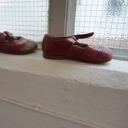 Children's shoes on the window sill